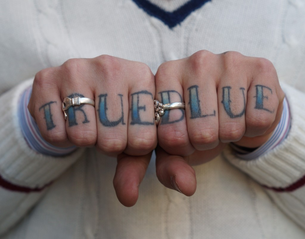 true blue finger tattooes